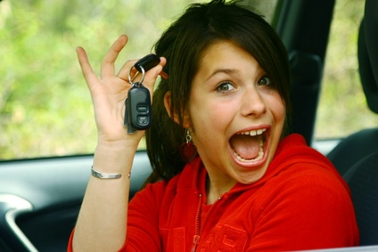 Proud teenager girl to drive a car